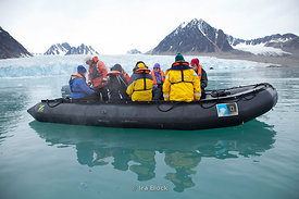 People from the National Geographic Explorer taking a zodiac cruise around Monaco Gracier in Woodfjorden, Northern Spitsbergen.