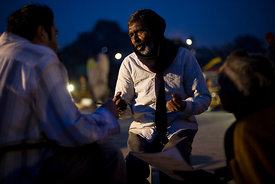 India - Delhi - Men with mental health problems talk to a volunteer psychiatrist in Urdu Park