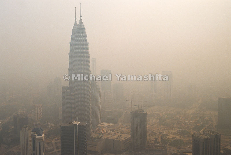 Smoke makes if difficult to see the rest of the Indonesian city.