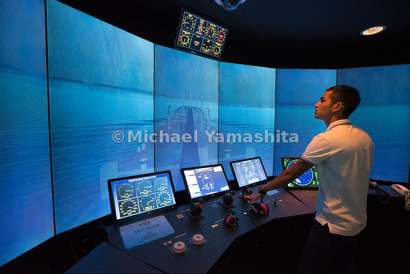 At the Singapore Maritime Academy's fully integrated simulation center, a cadet undergoes training inside a simulated navigation bridge. Across the screen, the vast ocean breaks into exciting ripples as the ship propels ahead, opening up endless possibilities.