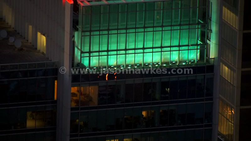 Aerial footage of illuminated office building at night, Canary Wharf, London