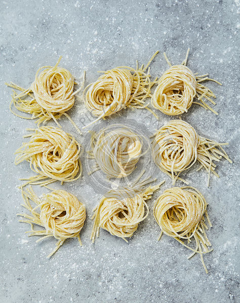 Fresh Pasta on Grey Stone Background