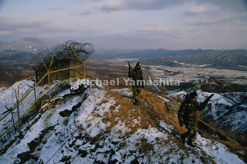Though soldiers guarding the DMZ carry only handguns and rifles, the armies massed on either side of it hold enough firepower to raize the peninsula. Equipped with chemical, biological, and possibly nuclear weapons, the North has targeted Seoul, South Korea's capital, with hundreds of artillery pieces. South Korean and U.S forces - with superior air and tank power - train constantly to repel an attack.