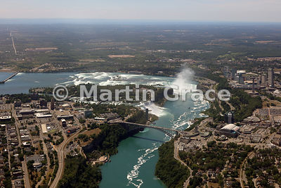 Niagara Falls from the air, looking over Niagara River to Rainbow Bridge; American and Bridal Veil Falls (USA); Goat Island (USA); Canadian Horseshoe Falls (Canada)