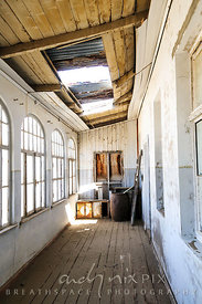 Empty, decaying buildings in an abandoned Victorian desert ghost town.