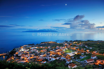 Vila Nova do Corvo in twilight. Flores island in the horizon. Azores, Portugal