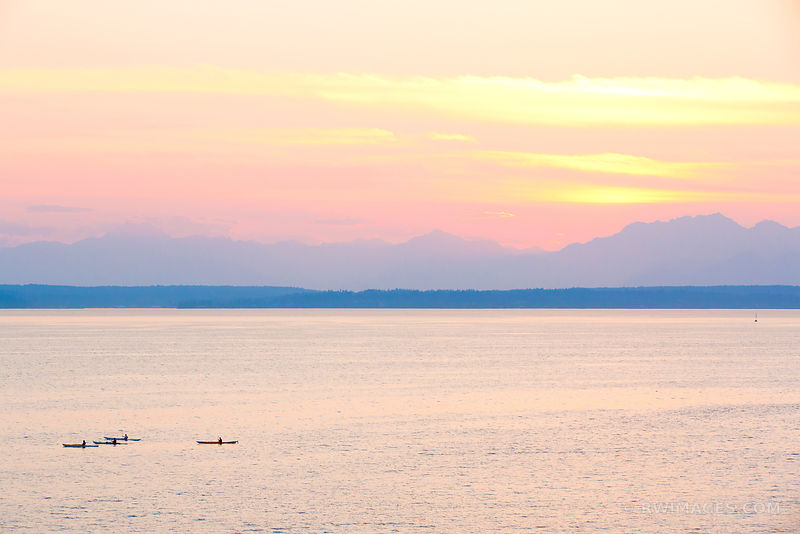 KAYAKERS IN PUGET SOUND AT SUNSET SEATTLE WASHINGTON