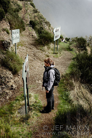 Hiker and trail signs