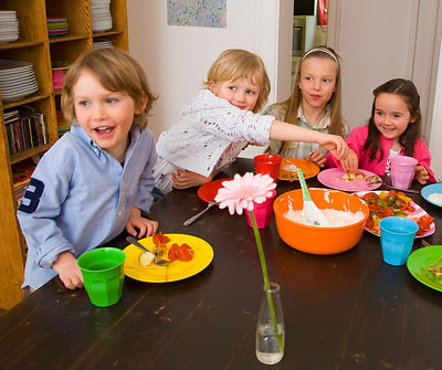 Children eating together at table