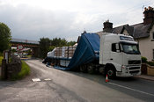 Articulated wagon passing under low railway bridge has roof of trailer ripped off Kirkby Stephen Cumbria
