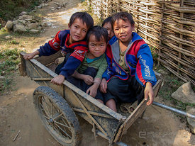 Hmong Children in Wooden Trailer