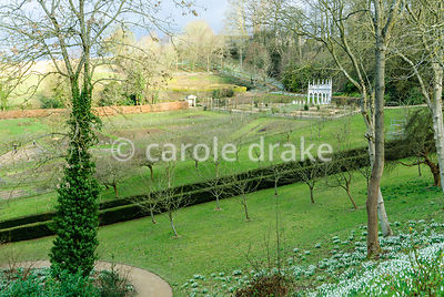 View from garden entrance down over the geometric kitchen garden with the Exedra at its head. Painswick Rococo Garden, Painswick, Glos, UK