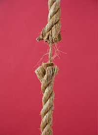 A rope about to break apart.