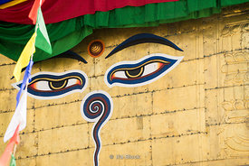 Scenes at the Monkey Temple, or Swayambhunath..Buddha's eyes and eyebrows painted on the stupa.