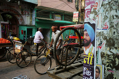 India - Delhi -Rickshaws and a political poster on the street in Sitaram Bazar