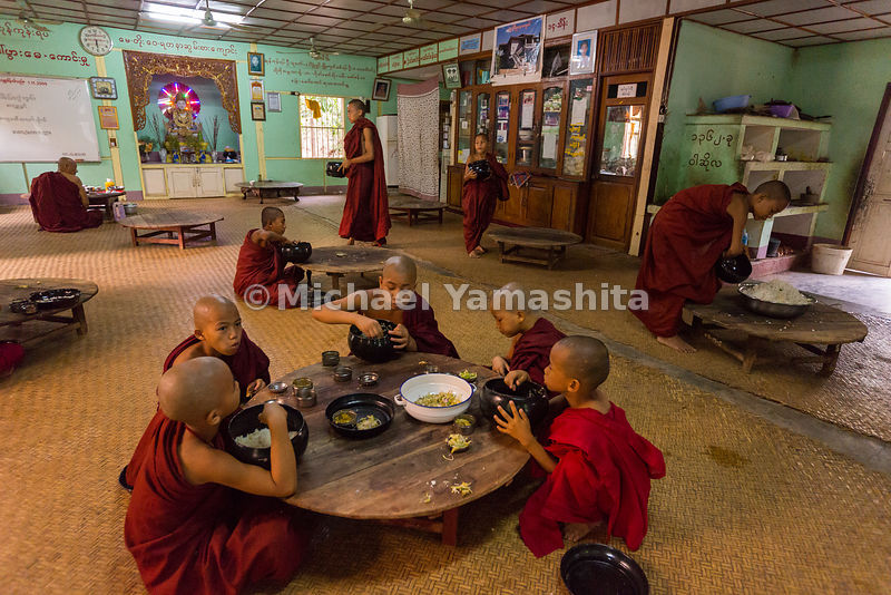 Breakfast is served to novice monks on squat wooden tables in Nyaung U, a town near Bagan.