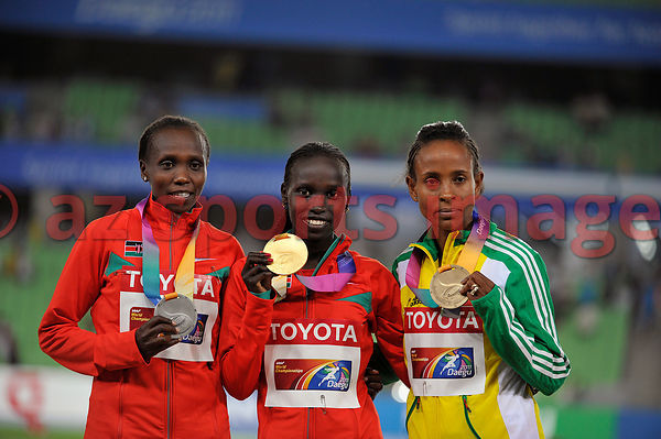 Vivian Jepkemoi Cheruiyot (centre) and S.Kibet (left) and Meseret Defar ETH (Right) hold up their medals on the winners podium. 5000m Daegu 2011 IAAF World Championships.
