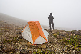 Backpacker on Foggy Morning in Camp Kiser along the Ptarmigan Ridge Trail