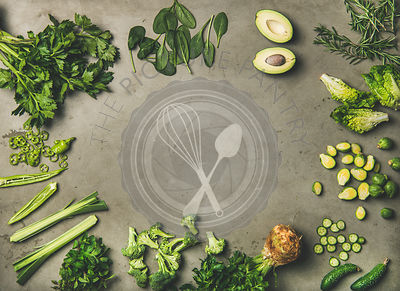 Flat-lay of whole and cut green vegetables and herbs