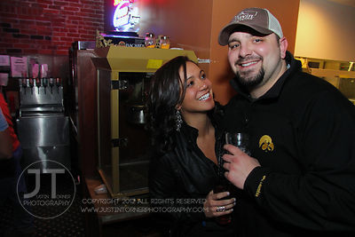 Bar patrons Lindsey Reed and Aric Kos react to the camera at the Airliner Bar, 22 S Clinton Street in downtown Iowa City Saturday night. Copyright Justin Torner 2012 http://justintorner.photoshelter.com