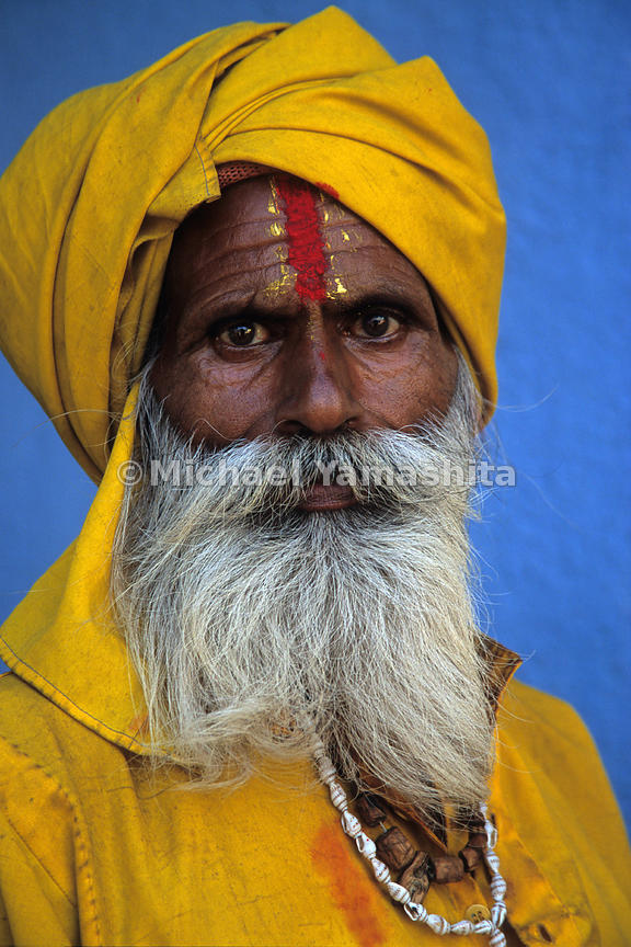A Sadhu, or holy man poses for a portrait. These ascetics who worship Shiva, renounce worldly goods in their goal to achieve spiritual enlightenment.