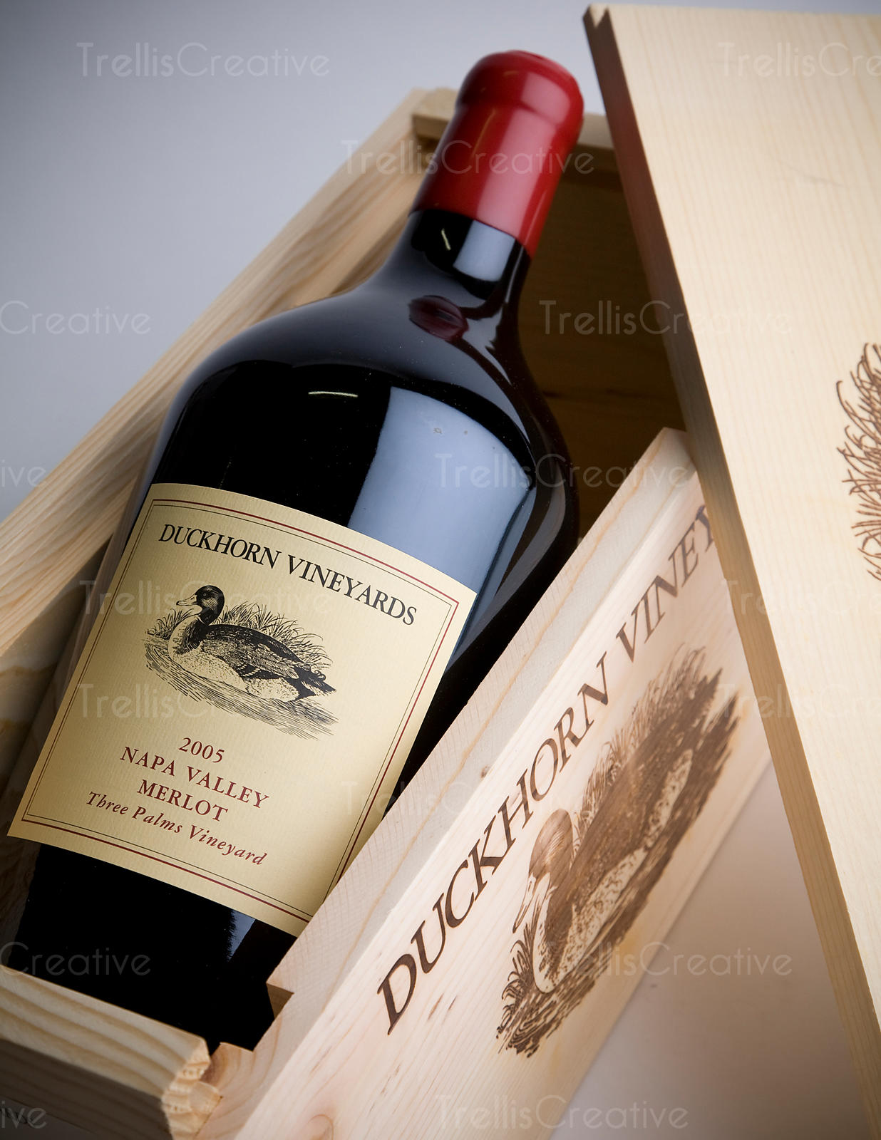 Magnum of red wine in opened wood box