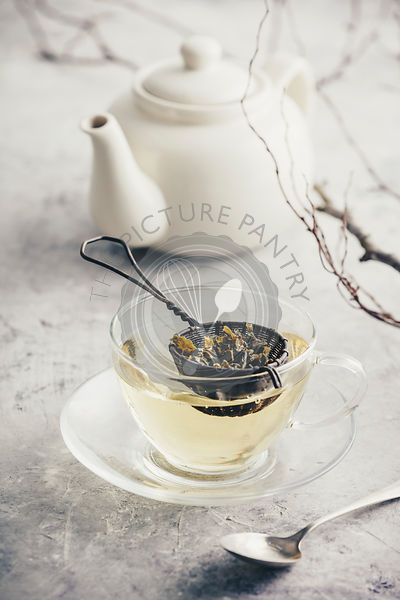 Tea composition with Cup of green tea and white teapot