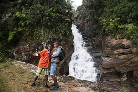 "Children take a ""selfie"" in front of a waterfall in the Vohimana reserve located near the Andasibe National Park on June 5, 2017."