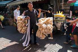 Portrait of a street vendor in Chinatown in Bangkok.