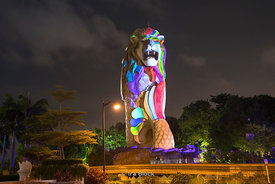 A night view of the Merlon magic lights in Sentosa, Singapore