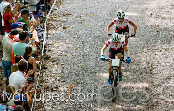 Catharine Pendrel (1) and Emily Batty lead the women's MTB XCO race from start to finish, Batty eventually taking the gold, Toronto 2015 Pan Am Games, Hardwood Mountain Bike Park, Oro-Medonte, On; July 12, 2015