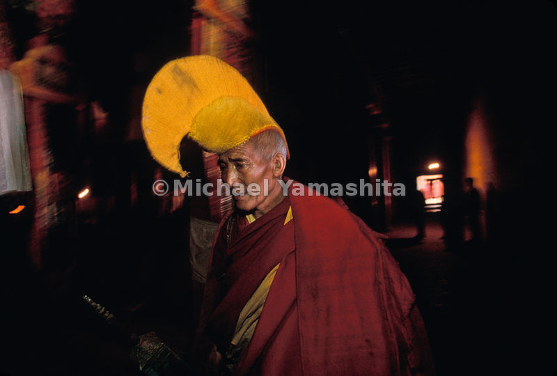 Bright headpiece, worn correctly, crowns the senior monk of an order of Tibetan Buddhists known as the Yellow Hats.