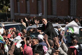 Marc Ravalomanana, former President of Madagascar, waves as he celebrates the 15th anniversary of his party Tiako i Madagasikara (TIM) with supporters, despite the ban of the meeting, in downtown of Antananarivo, on July 8, 2017.