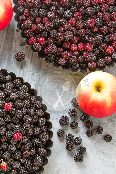 blackberries and rosy apples, for home baking a pie or crumble, agianst green marble,