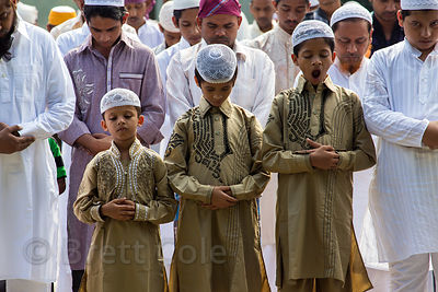 Muslim boys praying during Eid al-Adha, Red Road, Madian, Kolkata, India. I have the only photos taken by a foreigner of this most important day to Muslims at the most auspicious site in Kolkata for both 2012 and 2013.