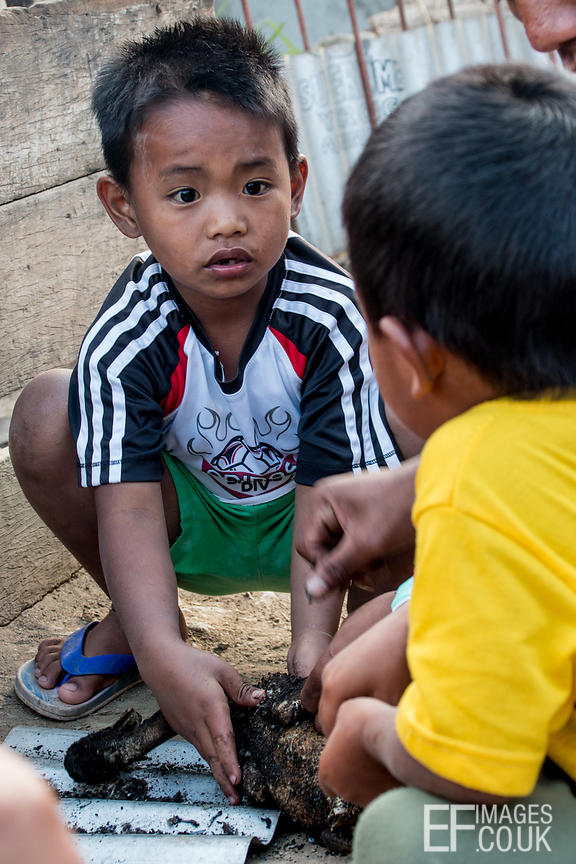Little Kalinga Tribe Boys Help To Pluck A Duck
