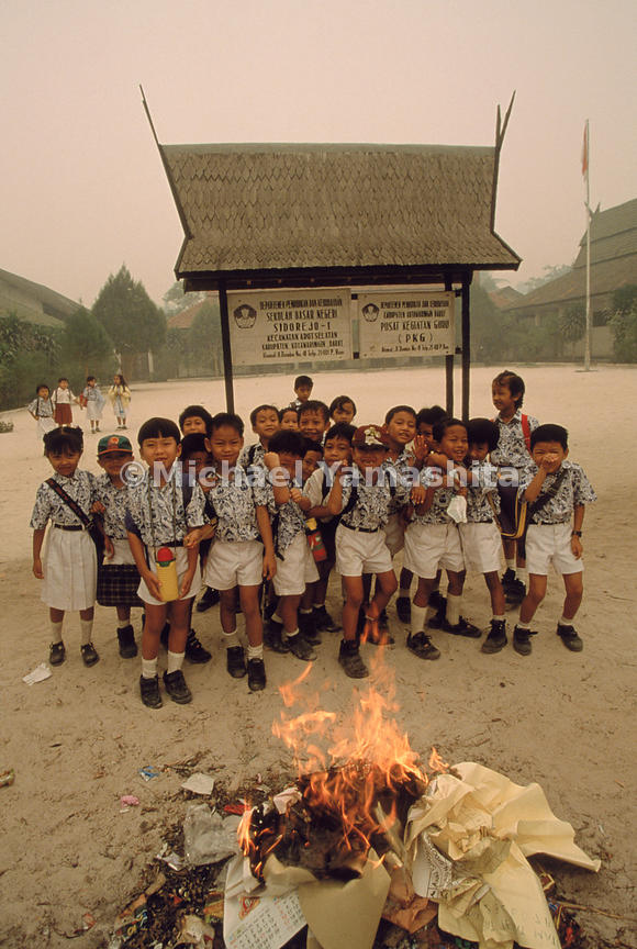 Despite roadside prohibitions and grim pollution alerts, schoolchildren in Kalimantan learn that fire is the handiest tool for cleaning up waste.