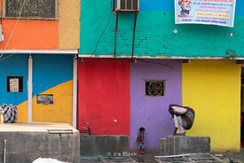 A washerman carrying a load of clothes at Dhobi Ghat, a laundry district in Mumbai, India.