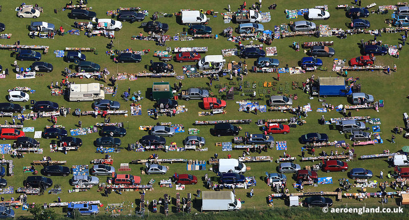 aerial photograph showing a car boot sale / Sunday market taking place at Newport Norfolk UK