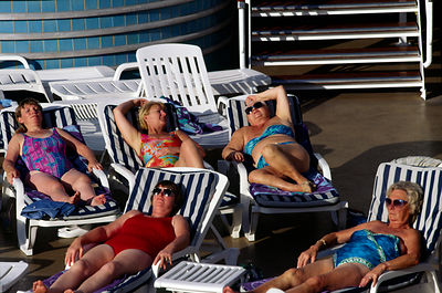 Portugal - Lisbon - Passengers sunbathe and talk on the deck of the P&O liner Oriana
