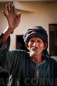 Old man waving goodbye.