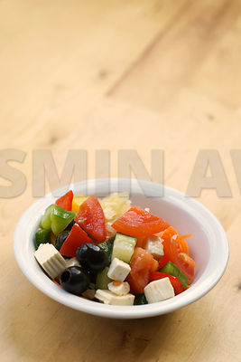 Fresh greek salad on wood table..copy space..Shallow DOF