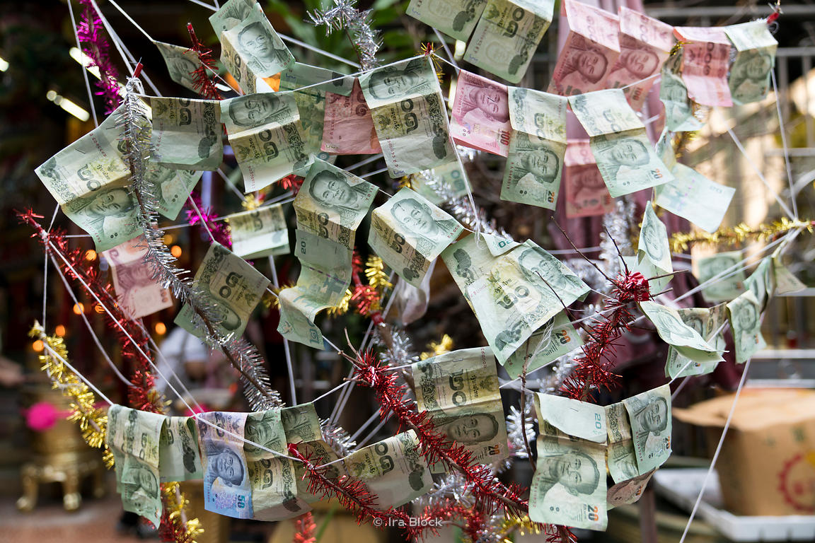 Currency notes being displayed at a street corner in Chinatown in Bangkok