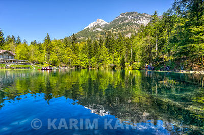 Mountain reflection over Blausee lake -  Bern
