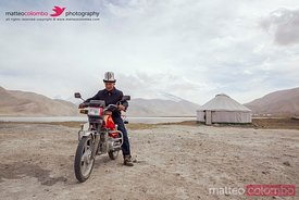Adult kyrgyz man riding his motorbike, Xinjiang, China