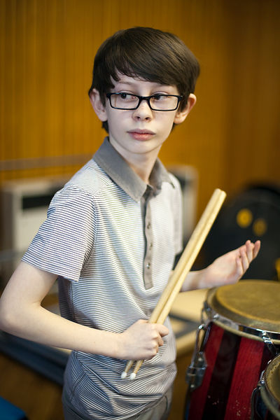 UK - Scunthorpe - A young percussionist waits for his cue during rehearsals of Cycle Song at the John Leggot College