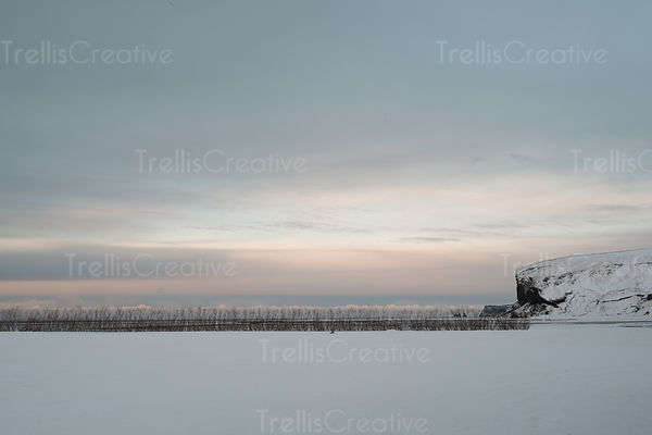 Warm pastel colors at dawn in a snowy Icelandic winter morning