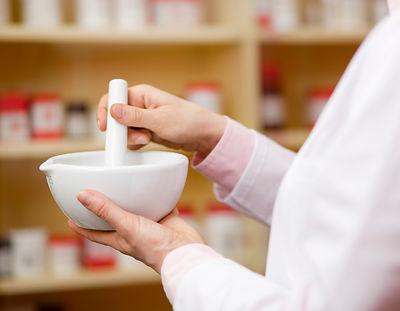 Pharmacist using mortar and pestle