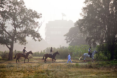 Horseback riders on the Maidan (a large park), Kolkata, India.