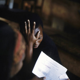 A woman receives her AIDS test result with shock at Kibayi Health Centre. Rwanda